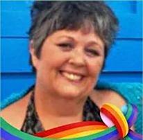 Board secretary, Elle Gallagher, ensures sensitivity to diverse communities.